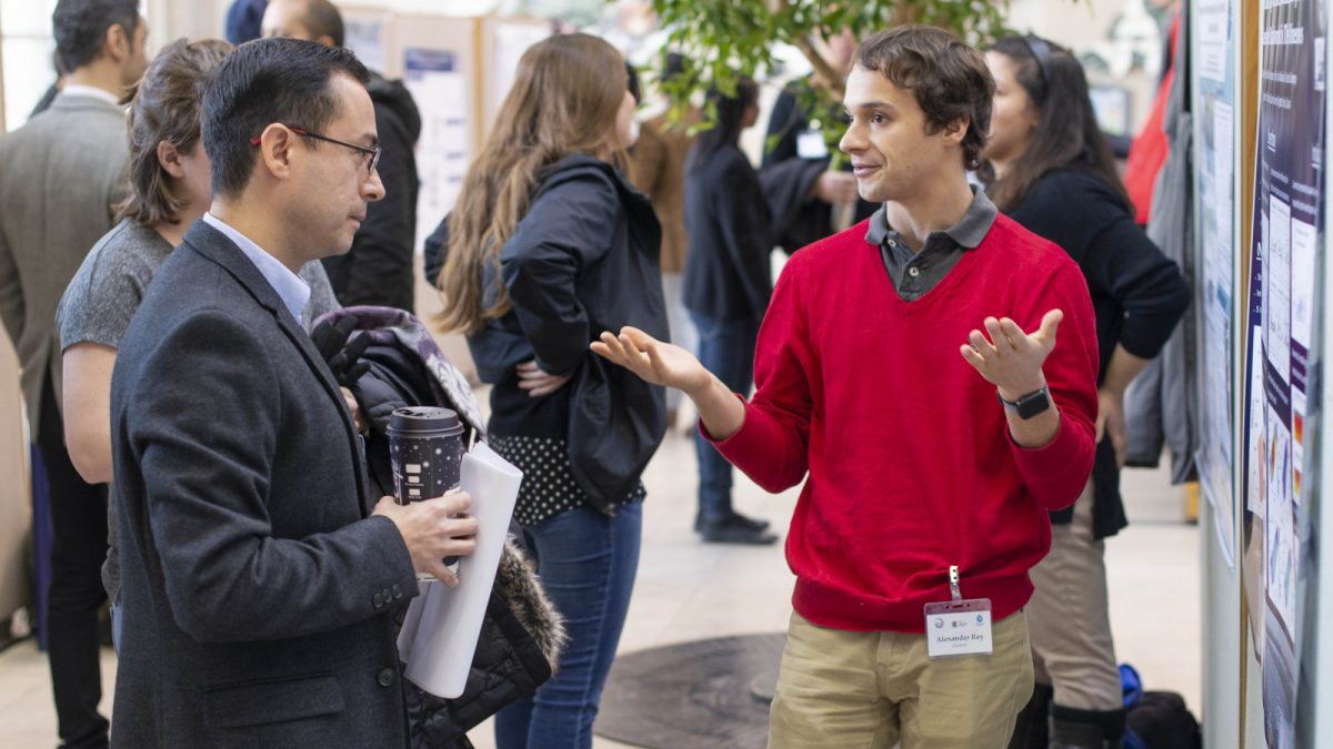 Ph.D. Student Alexander Rey presenting his poster to Dr. Carlos Escobedo.